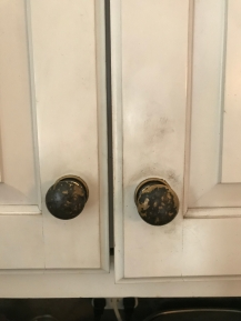 Worn away paint on frequently used cabinets
